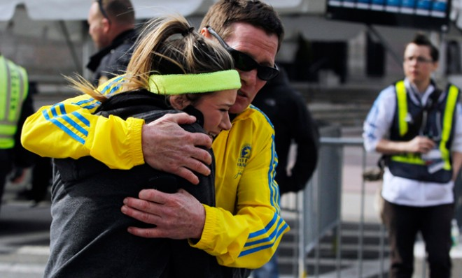 A woman is comforted after two explosions rock the 117th Boston Marathon on April 15. Photo by Reuters/Jessica Rinaldi